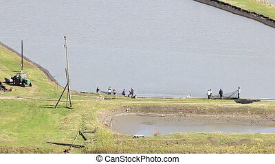 fishpond and workers agriculture
