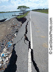 Fissures and erosion of the asphalt road by the earthquake.