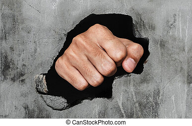 Fist breaking concrete wall