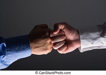 Fist bump handshake between businessmen