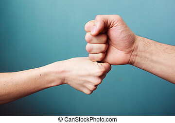 Fist bump two businessmen greeting with a fist bump isolated on white fist bump m4hsunfo