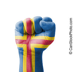 Fist of Aland Islands flag painted, multi purpose concept - isolated on white background