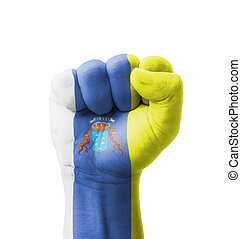 Fist of Canary Islands flag painted, multi purpose concept - isolated on white background