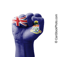 Fist of Cayman Islands flag painted, multi purpose concept - isolated on white background