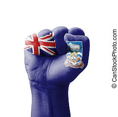 Fist of Falkland Islands flag painted, multi purpose concept - isolated on white background