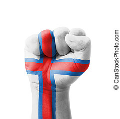 Fist of Faroe Islands flag painted, multi purpose concept - isolated on white background