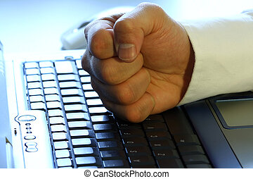 Fist on laptop - Businessman's fist on laptop, showing anger...