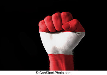 Fist painted in colors of austria flag