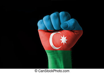 Fist painted in colors of azerbaijan flag