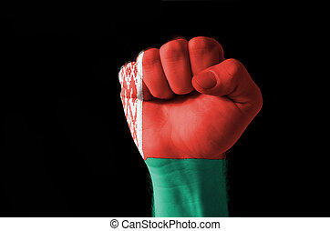 Fist painted in colors of belarus flag
