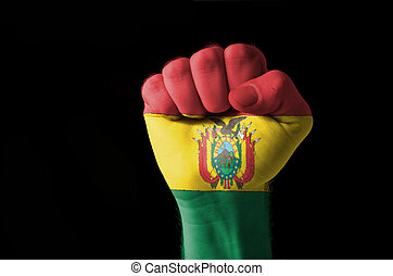 Fist painted in colors of bolivia flag