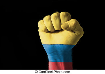 Fist painted in colors of columbia flag
