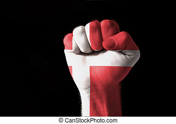 Fist painted in colors of denmark flag - Low key picture of...