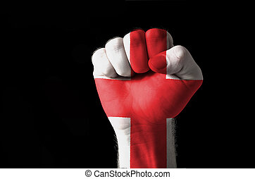 Fist painted in colors of england flag - Low key picture of...