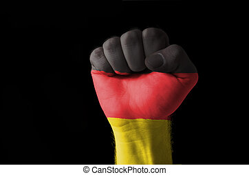 Fist painted in colors of germany flag