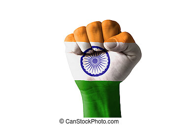 Fist painted in colors of india flag - Low key picture of a...