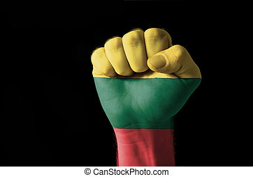 Fist painted in colors of lithuania flag