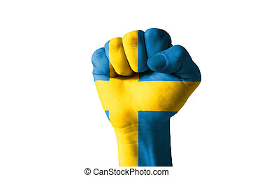 Fist painted in colors of sweden flag - Low key picture of a...