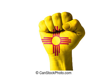 Fist painted in colors of us state of new mexico flag