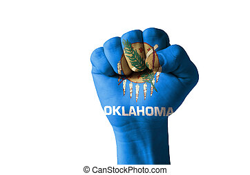 Fist painted in colors of us state of oklahoma flag - Low...