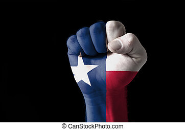 Fist painted in colors of us state of texas flag - Low key...