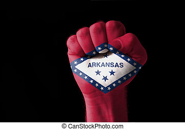 Fist painted in colors of us state of arkansas flag - Low...