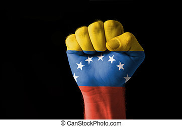 Fist painted in colors of venezuela flag