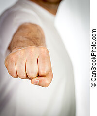 Fist punch by man in white