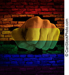 Fist punching through rainbow wall