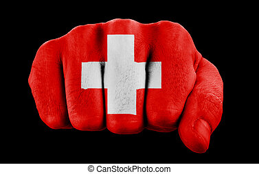 fist with swiss flag isolated on black