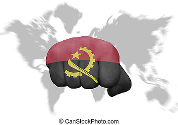 fist with the national flag of angola on a world map background