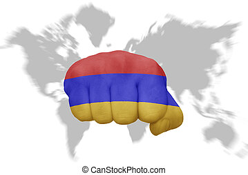 fist with the national flag of armenia on a world map background
