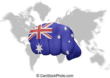 fist with the national flag of australia on a world map background