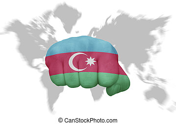 fist with the national flag of azerbaijan on a world map background