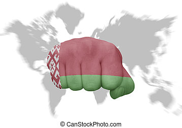fist with the national flag of belarus on a world map background