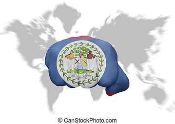 fist with the national flag of belize on a world map background