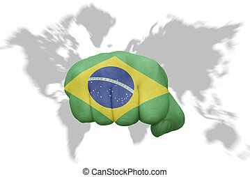 fist with the national flag of brazil on a world map background