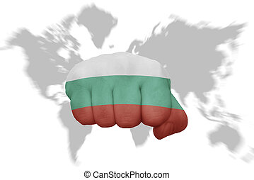 fist with the national flag of bulgaria on a world map background