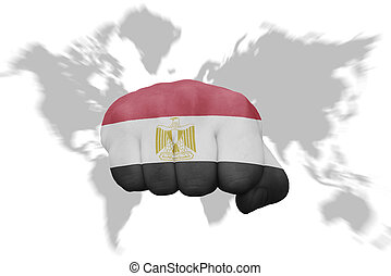 fist with the national flag of egypt on a world map background
