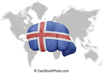 fist with the national flag of iceland on a world map background