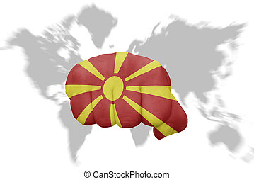 fist with the national flag of macedonia on a world map background