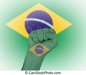 Fist wrapped in the flag of Brazil