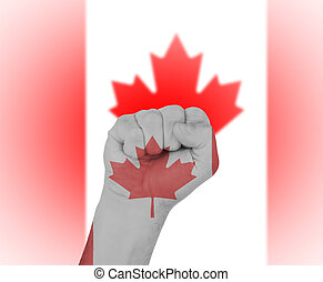 Fist wrapped in the flag of Canada