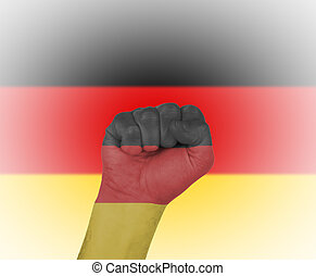 Fist wrapped in the flag of Germany