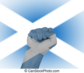 Fist wrapped in the flag of Scotland