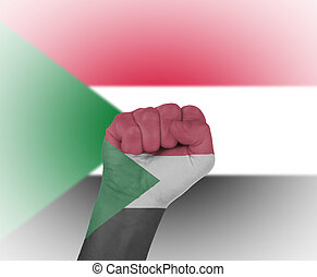 Fist wrapped in the flag of Sudan
