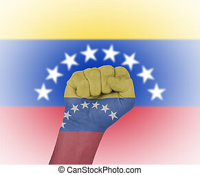 Fist wrapped in the flag of Venezuela