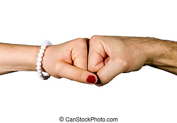 The fist of a woman and a man bumping together