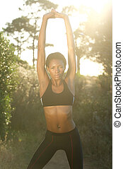 Fit african american woman stretching exercise outdoors