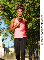 Fit african american young female jogging in morning